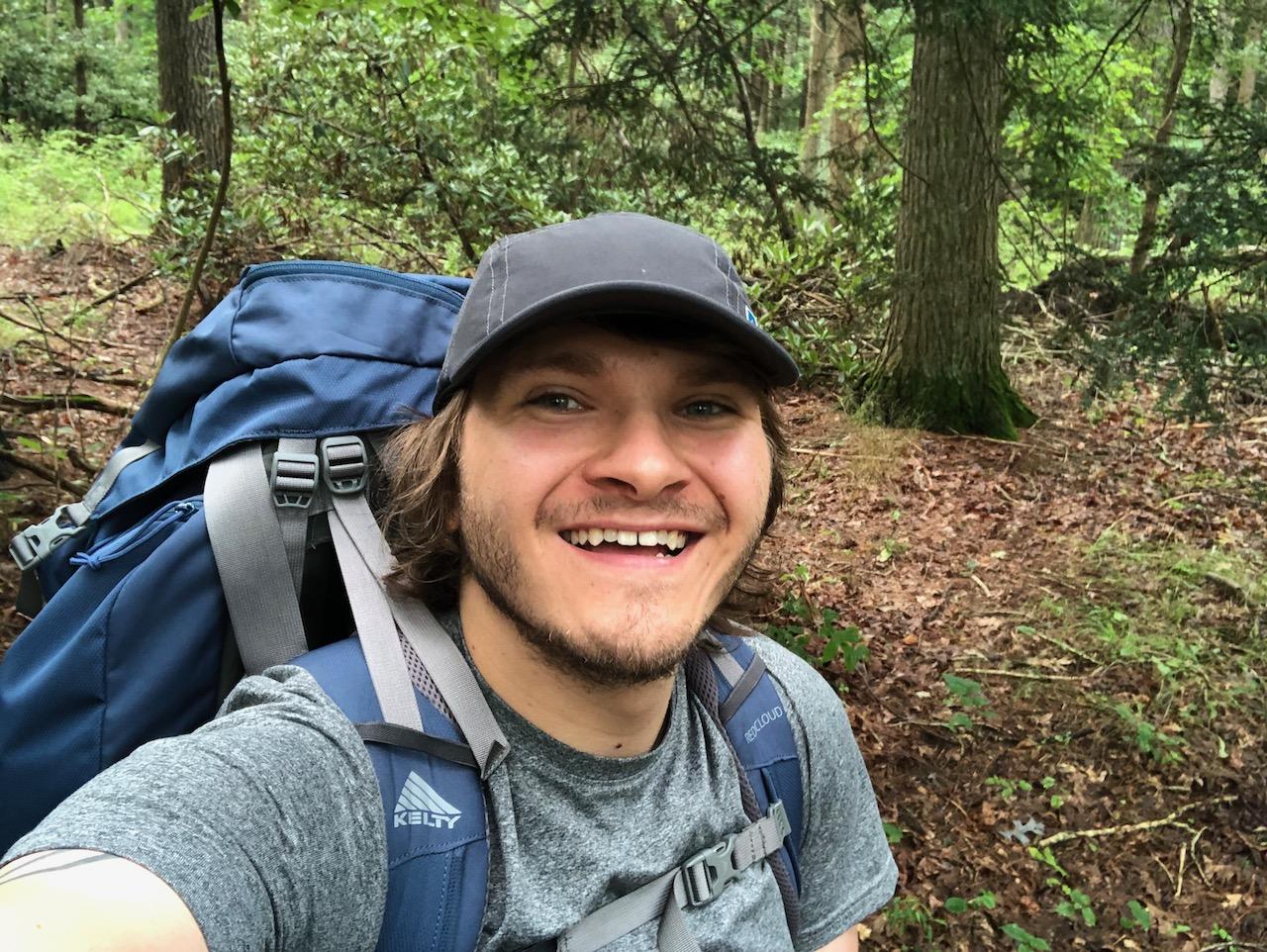 Selfie photo of Brett at the start of the hike